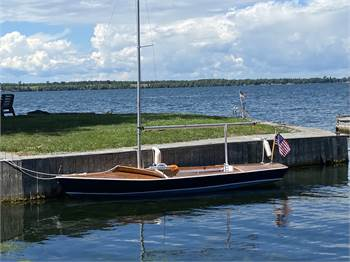 A Classic 16 foot Snipe Class Wooden Sailboat